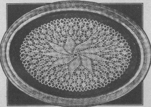 Doily with solid star motif on lacy background