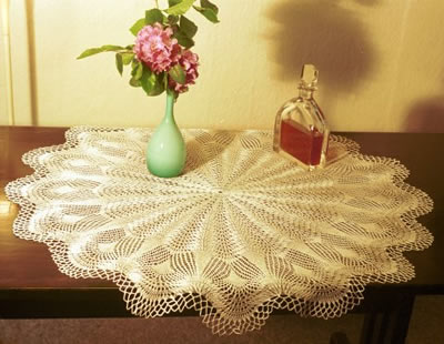 Doily with peacock feather design